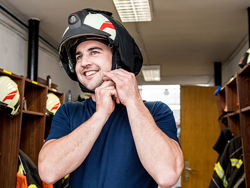 fireman putting on his helmet